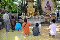 Bangkok, Thailand: People Praying at Thai Wat Royalty Free Stock Images