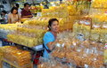 Bangkok, Thailand: Smiling Clerk at Tor Kor Market Stock Photos