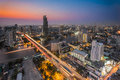 Bangkok Transportation at Dusk with Modern Business Building alo Royalty Free Stock Photo