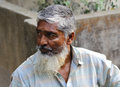 Bangladeshi old man age see something Stock Photo