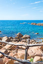 Banister and rocks wooden by costa paradiso rocky shore Royalty Free Stock Image