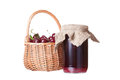 Bank with cherry jam and a basket ripe cherries Royalty Free Stock Photo