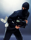 Bank robbery - Male thief running with handbag Royalty Free Stock Image