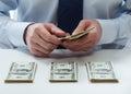 Bank teller counting dollar banknotes Royalty Free Stock Photo