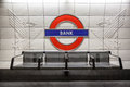 Bank underground station logo two eagles bench london england Stock Photos