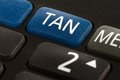 Banking with a tan generator closeup view from tool to generate numbers Royalty Free Stock Image
