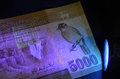 Banknote glow under uv modern with the new security feature fluorescent print which rays Stock Image