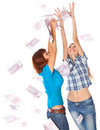 Banknotes of 500 euro are falling on two girls Stock Photography
