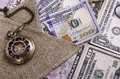 Banknotes hundred dollars and other denomination burlap and poc pocket watches close up Stock Photo