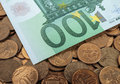 Banknotes of one hundred euros on coins Stock Photography