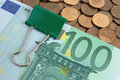 Banknotes of one hundred euros on coins Stock Photos