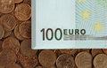 Banknotes of one hundred euros on coins Royalty Free Stock Photo