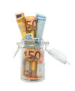 Banknotes in opened jar Stock Photography