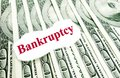 Bankruptcy bankrupty text on a paper scrap over money Royalty Free Stock Photo
