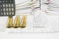 Bankruptcy of house and collapse pile of gold coins on finance account have calculator place vertical with paperwork as background Stock Images