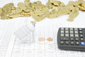 Bankruptcy of house have stack of gold coins as background with calculator on finance account Stock Photo