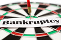 Bankruptcy sign pinned on darts Royalty Free Stock Photography