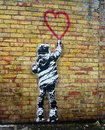 Banksy style stencil art. Child painting a heart shape