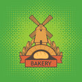Banner for bakery shop with mill, baguette and ears Royalty Free Stock Photo