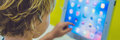 BANNER Boy playing with digital tablet. Children and technology Royalty Free Stock Photo