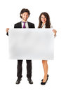 Banner business partners an elegant couple holding a blank whiteboard and promoting something Stock Image