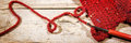 Banner, Crochet hook and red scarf, handiwork and fashion Royalty Free Stock Photo