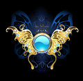 Banner with gold wings of a butterfly blue jewelry on black background Royalty Free Stock Images