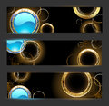 Banner with golden rings and turquoise glass circles on a black background Royalty Free Stock Photos