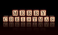 Banner Merry Christmas in 3d wooden cubes Stock Photo