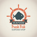 Banner for seafood shop with fish and a ship helm