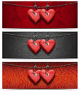 Banners with wooden hearts two handmade red hanging on a steel cable on fabric background Stock Images