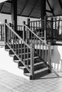 Bannister shadow on wooden stair step of the Royalty Free Stock Photo
