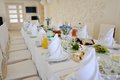 Banquet table a beautifully decorated with white towels in a bright room Royalty Free Stock Image