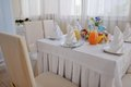 Banquet table children s with blue teddy bears and fruit and juice Royalty Free Stock Images