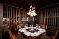 Banquet table restaurant brown wooden interior Royalty Free Stock Photo