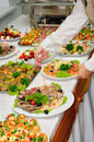 Banquet table served with canape luxury canapés and chafing dishes Royalty Free Stock Images