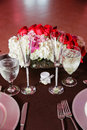 Banquet table settings and flowers Royalty Free Stock Photo