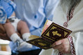 Baptism reading prayers priest from the holly bible during christening ceremony Royalty Free Stock Image