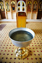 Baptismal font near altar in Christian church Royalty Free Stock Photo