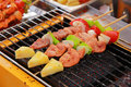 Bar b q or bbq grill of meat skewers barbecue sticks with and vegetables Stock Photo
