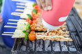 Bar-B-Q or BBQ with kebab cooking. coal grill of chicken meat sk Royalty Free Stock Photo