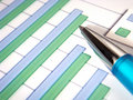 Bar chart with pen Royalty Free Stock Photo