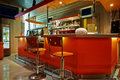 Bar counter barstools empty cafe bar orange interior Royalty Free Stock Images