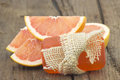 Bar of glycerine soap and grapefruit Royalty Free Stock Photo