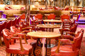 Bar scene with some red chairs and tables Stock Photo