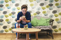 Bar smart casual young man writing message on smartphone. Royalty Free Stock Photo