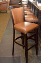 Bar stool studded brown located in a bistro Stock Photography