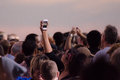 Crowd taking pictures with cell phones, event. Royalty Free Stock Photo
