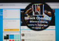 Barack obama photo of s official twitter page on a monitor screen through a magnifying glass Stock Photography