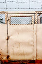Barb wire door iron outdoor Stock Image